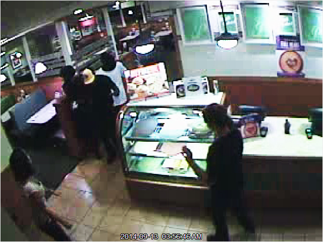 PHOTO: Armed Robbery suspects-Both suspects were completely covered from head to foot, making it extremely difficult to obtain accurate descriptions from witnesses. The first suspect wore a black, long-sleeved shirt, and had a silver revolver. The other suspect had on a white long-sleeved shirt and socks over his hands. (Photo Courtesy ofCape Coral Police Department)