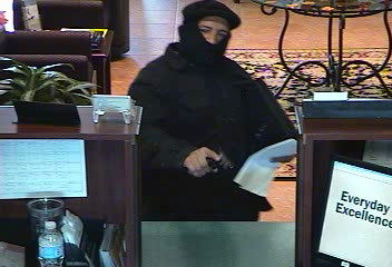 "PHOTO:  A subject wearing all black and a ""ninja mask"" and displaying a firearm robbed the Iberia Bank at 812 Del Prado Boulevard S. This morning.  (Photo Courtesy of Cape Coral Police Department)"
