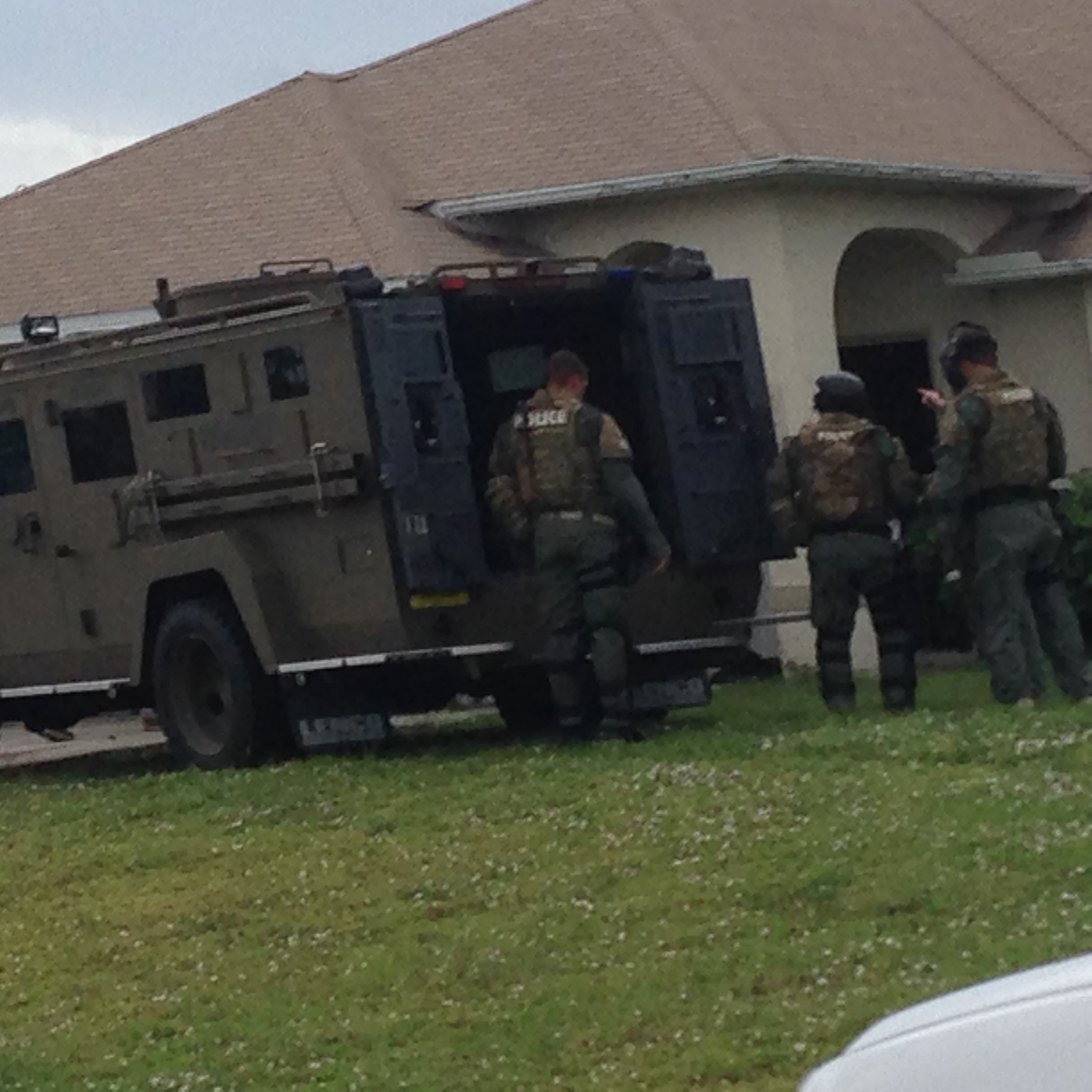 PHOTO: Cape Coral Police Department SWAT Team executes a search warrant on the home of the Iberia Bank robbery suspect. (Photo Courtesy of Cape Coral Police Department)