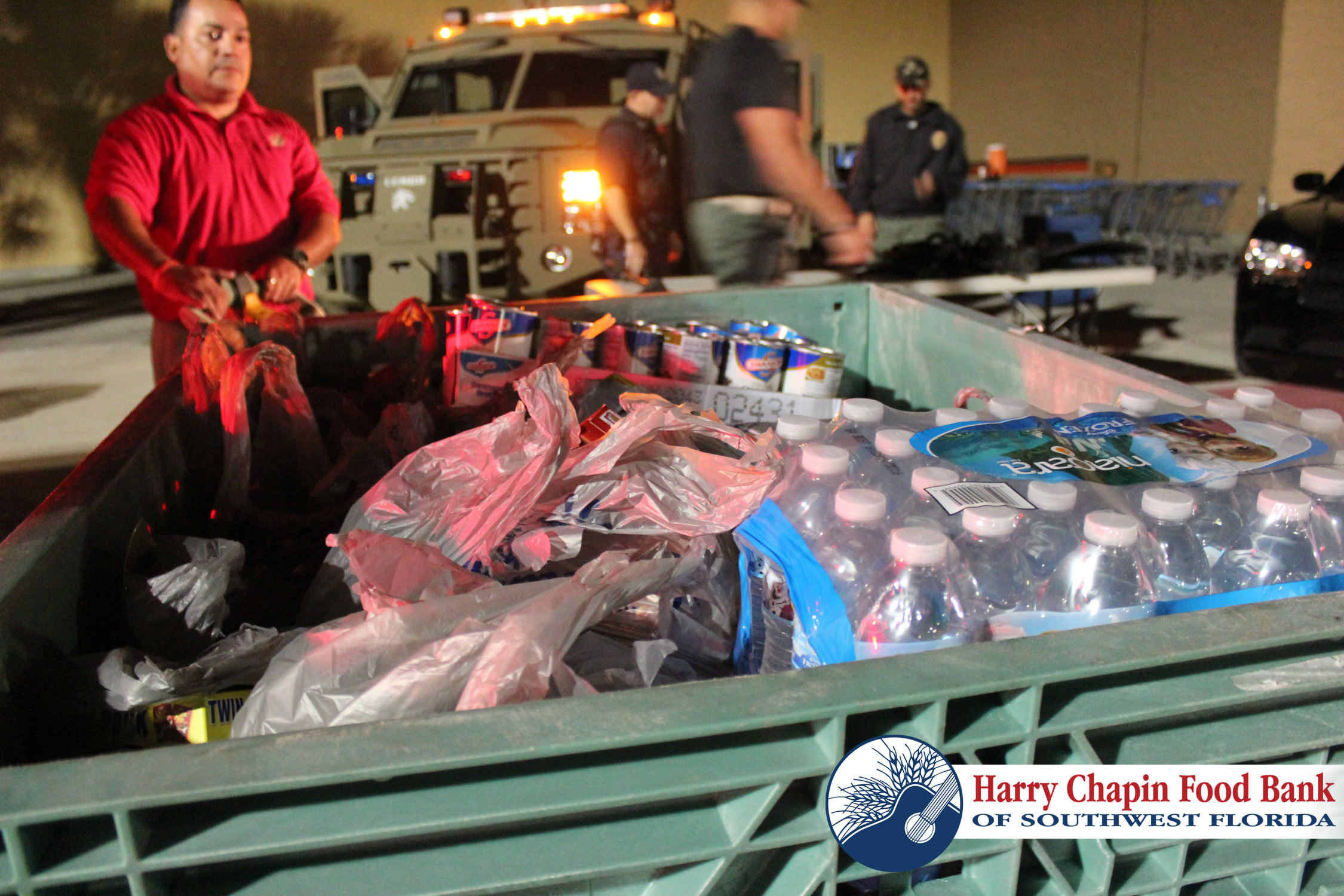 "PHOTO:  Members of the CCPD SWAT Team, Street Crimes Unit, K9, and Marine Unit collected over 2400 lbs. of canned food in the 2014 Cape Coral Police Department ""Holiday Heroes"" Food Drive.  (Photo Courtesy of Harry Chapin Food Bank of Southwest Florida)"