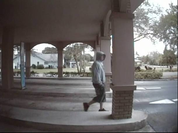 "PHOTO:    The robbery suspect was described as a white male, approximately 30 years old, 6""00"", 190 lbs., wearing black sneakers. The shorts in the photo appear to be jeans which were cut and made into shorts  .  (Photo Courtesy of   Cape Coral Police Department  )"