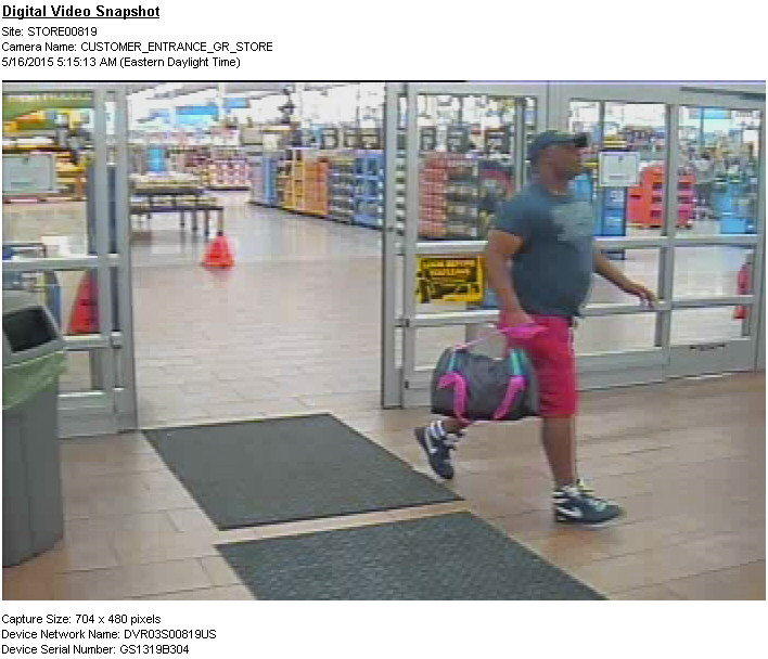 PHOTO:  Suspect leaving Wal-Mart in a hurry with a bag laden with stolen razors on May 16, 2015.  (Photo Courtesy of Cape Coral Police Department)