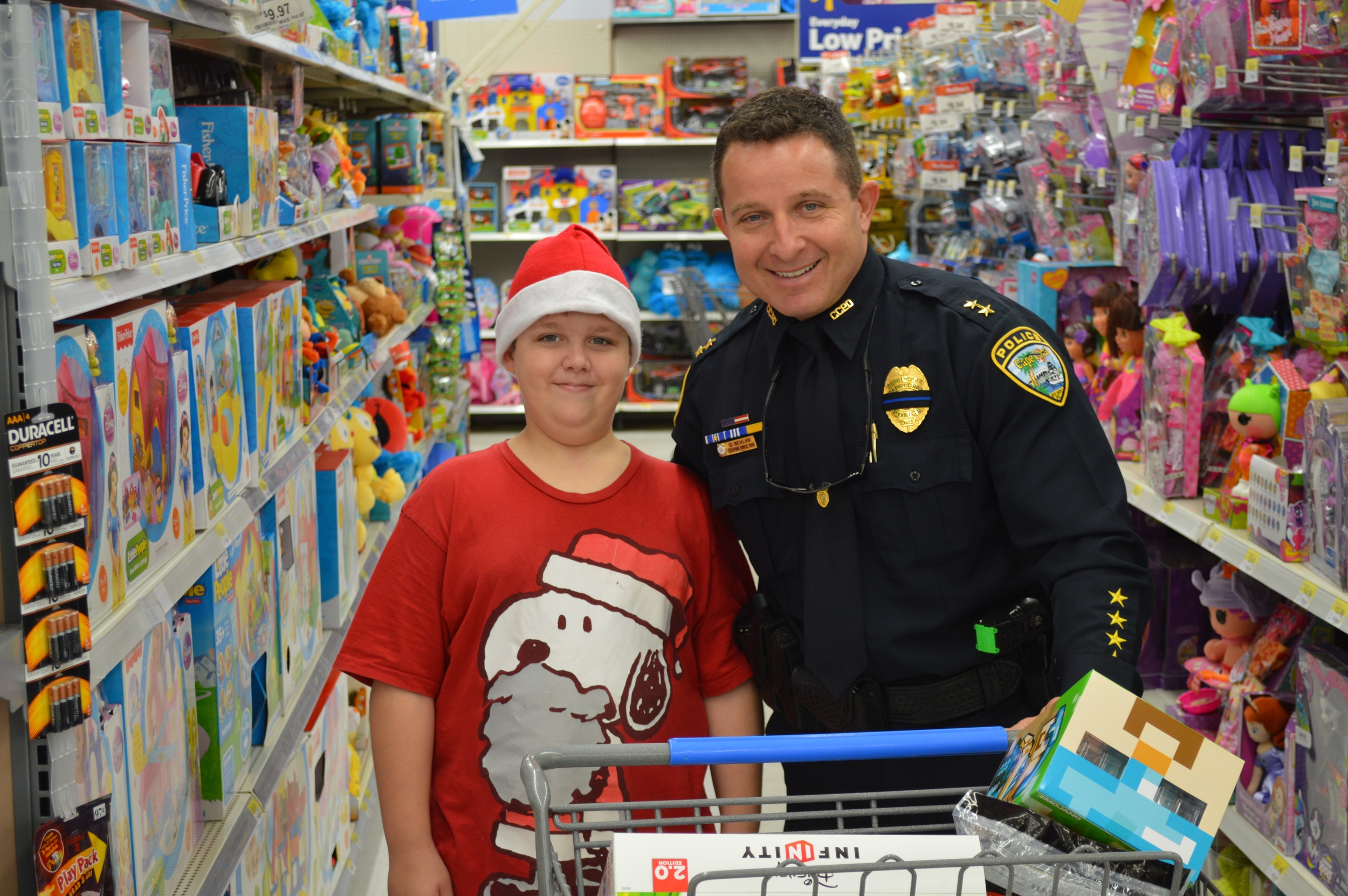 """PHOTO: December 21, 2015 will mark the Cape Coral Police Department's 13th annual """"Shop With a Cop."""". (Photo Courtesy of Cape Coral Police Department)"""