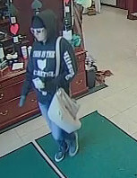 Still photographs of suspect in bank robbery of Busey Bank, 2524 Del Prado Blvd. South.