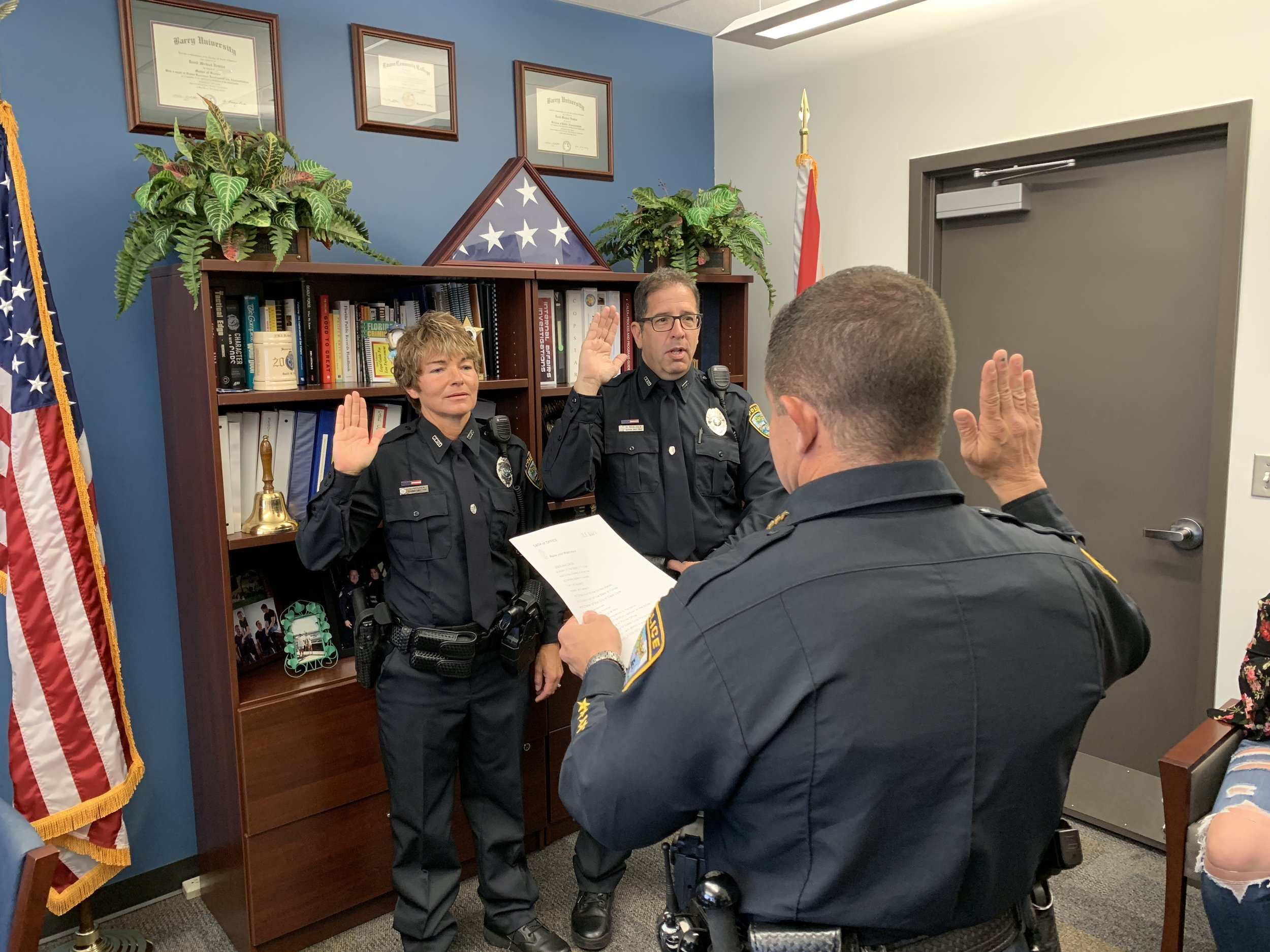 Chief Newlan swearing in Officers Bogliole and Nielsen.