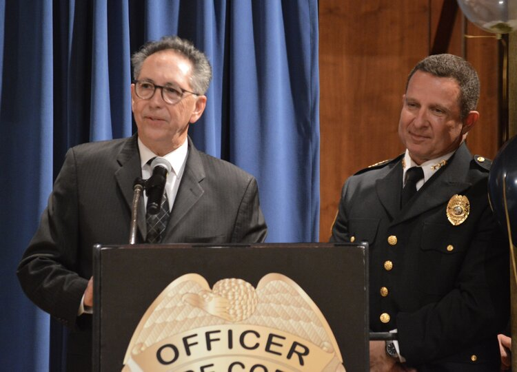 City Manager John Szerlag speaks about the department's accomplishments with Chief Newlan.