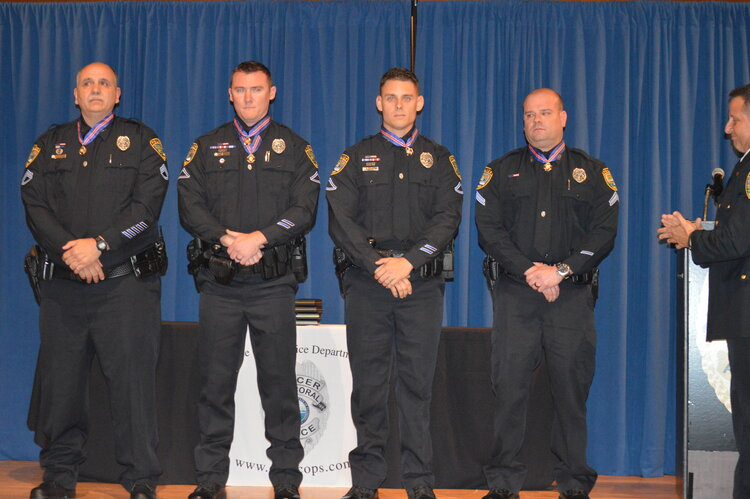 CCPD Medal of Honor recipients, L to R: K-9 Ofc. Robert Reese, Ofc. Andrew Miller, Ofc. John DiGiovanni, Ofc. Christopher Gugliotta