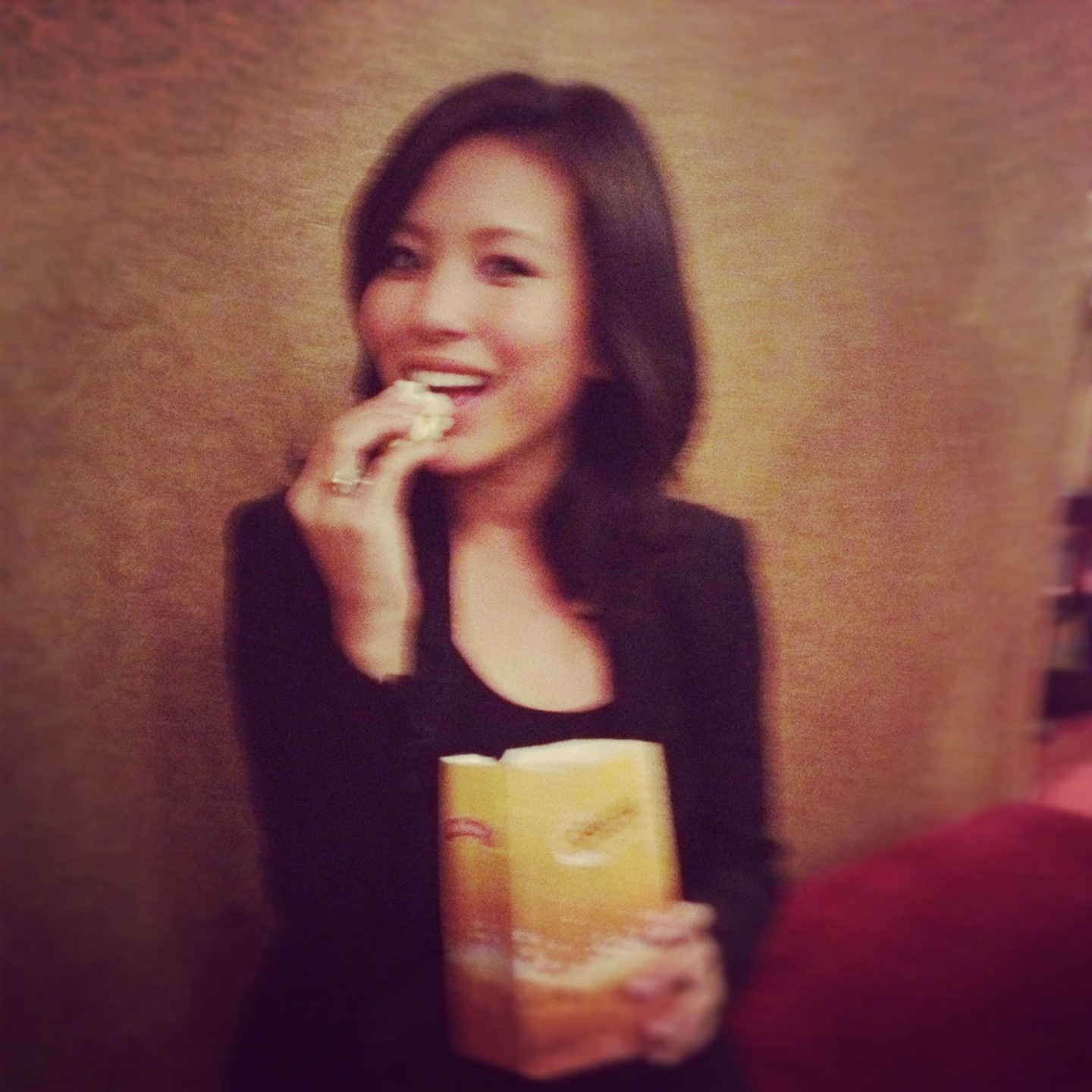 Me, eating complimentary movie popcorn at Ziegfeld Theater #singlegirldinner