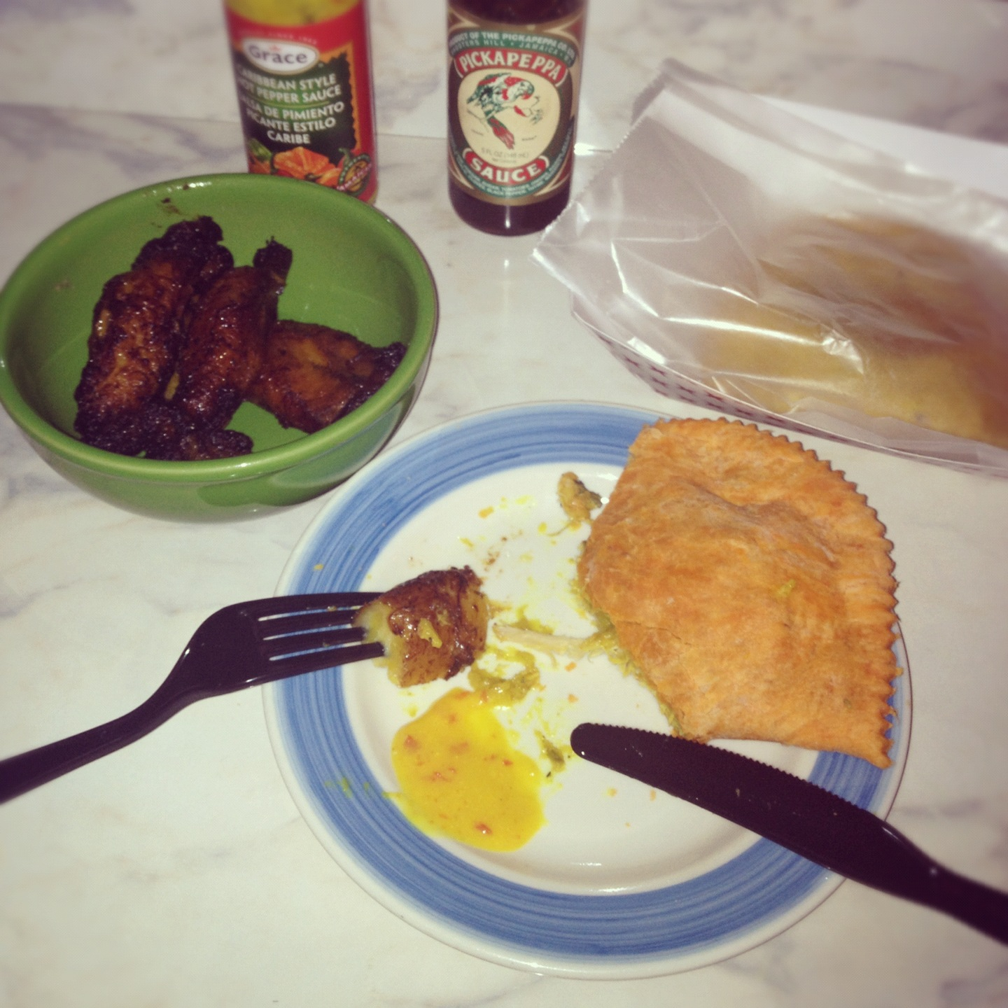 My humble Jamaican curry chicken patty and plantain dinner at Miss Lily's Bake Shop.