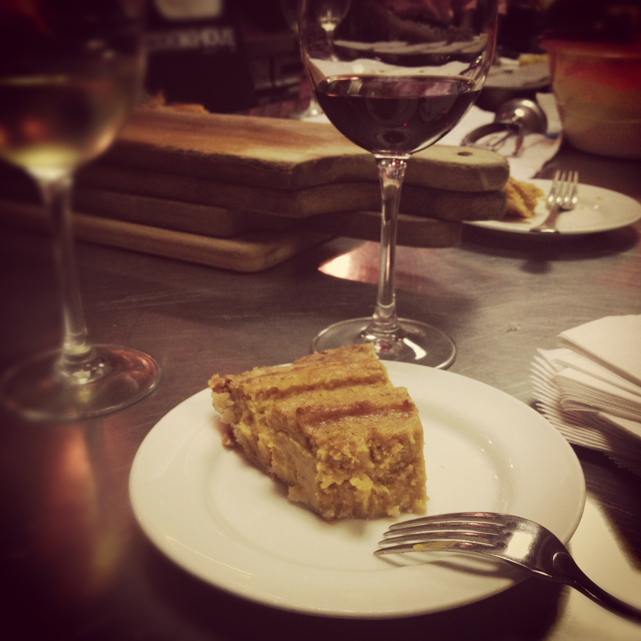 A slice of sweet potato pie and a glass of red wine #singlegirldinner