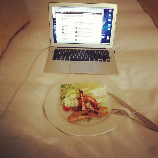 Grilled shrimp Caesar salad for lunch in my hotel suite at Casa Velas, with the Twitter feed going nearby and CNN on the TV