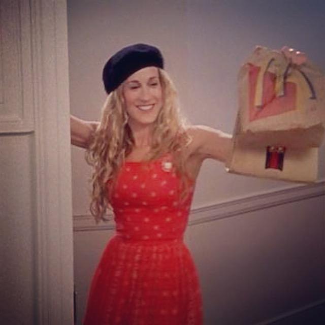 """Bonjour! Voilà, le French hat; voilà, le french fry!"" says Carrie Bradshaw, surprising Mr. Big with a McDonald's dinner."