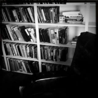 a picture of books and a chair