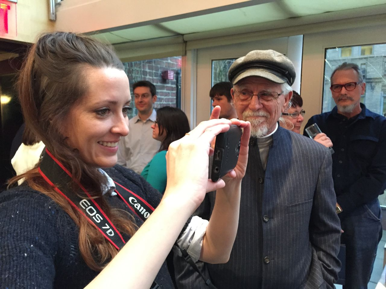 Charli James (@Charli), a video producer/journalist taking a picture of her parents with her grandfather looking on.