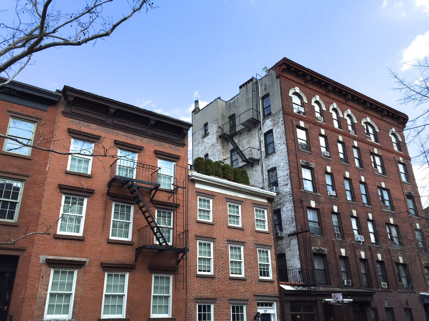 There seem to be a few open windows in the large building at the far right.