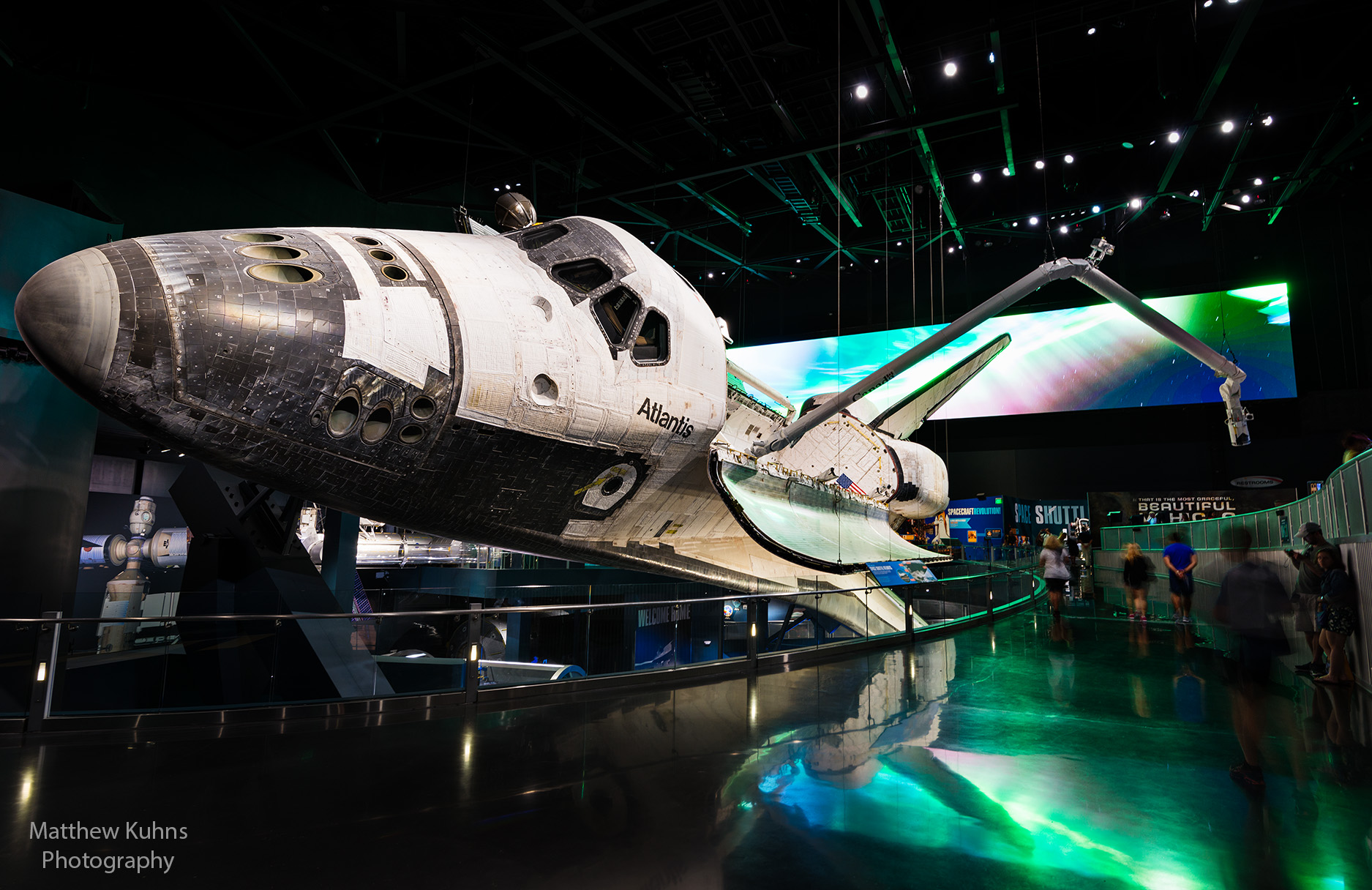 Atlantis.  Mounted on her side with the bay doors open and Aurora on a projection screen behind.  33 missions over 26 years carrying 207 astronauts 126 million miles over 307 days in space.
