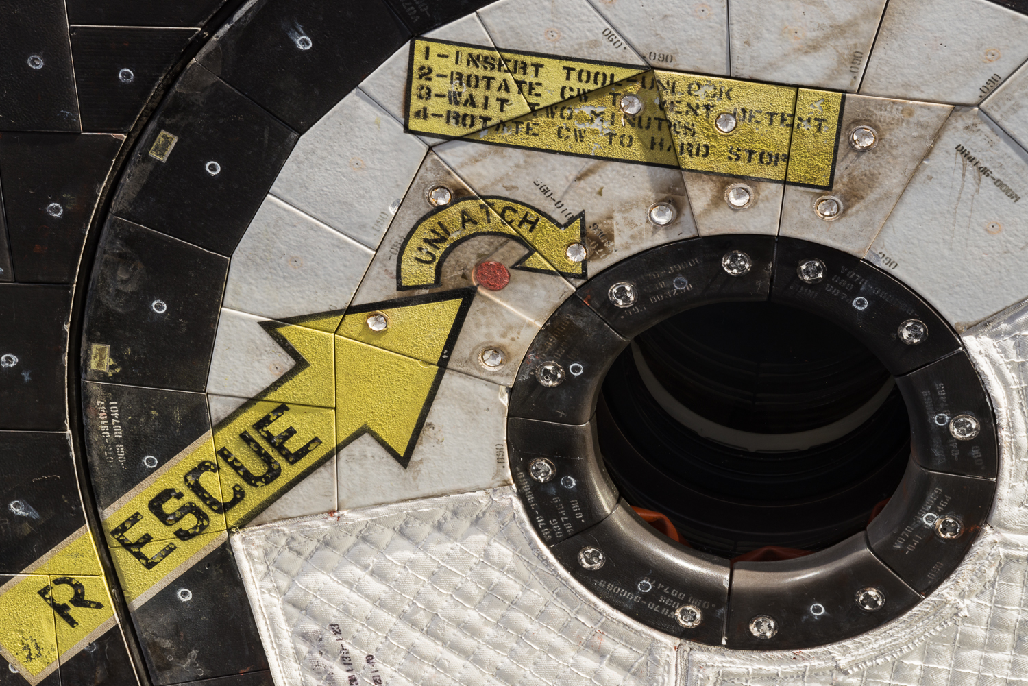 Detail image of the crew hatch with rescue instructions.  Thats NASA, safety first.