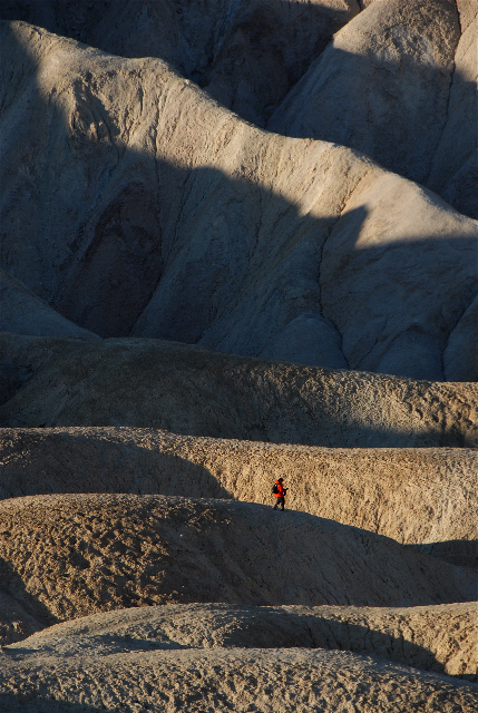 Matthew walking through Golden Canyon in Death Valley during a sunrise shoot. Image by Palmore Clarke