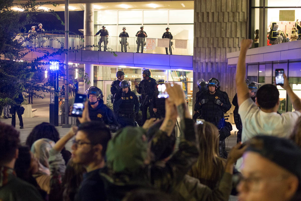 Police keep protestors at bay during a conservative speaking event at UC Berkeley. 9/14/17