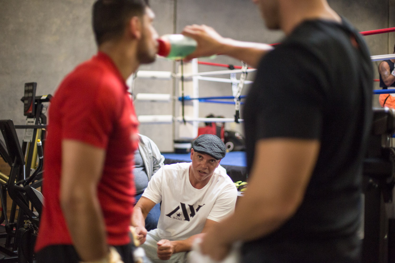 Boxer Amir Khan listens to his coach while training for a fight against Canelo Alvarez. San Leandro, CA. April 2016.