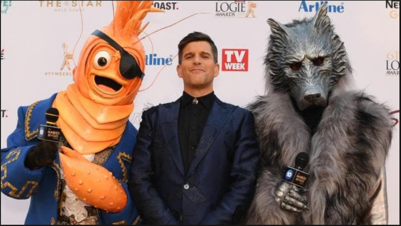 Osher Günsberg  ,  host of  The Masked Singer  with some of the costumes to be used on the Australian series  PHOTO: news.com.au