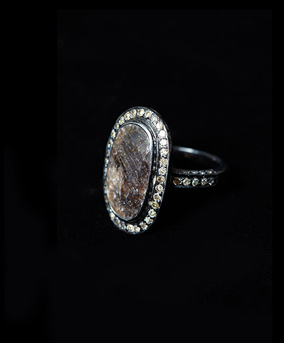 Black-Oval-Diamond-RIng-7ct-Main-Diamond-6.8ct-Diamonds-Surrounding-Ring-and-on-Shank-Silver-with-Black-Rhodium-Finish.jpg