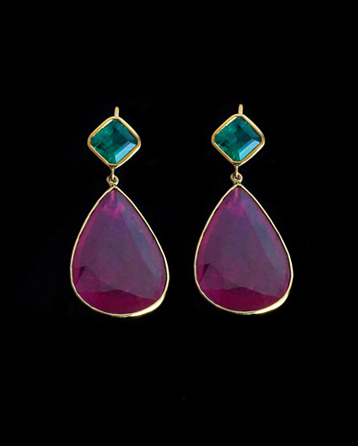 25.54ct-Rubies-with-2.57ct-Emerald,-18k-Gold-8.53-Grams.jpg