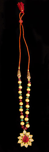 Garnet-and-Polki-flower-Pendant-with-Gold-Beads.jpg