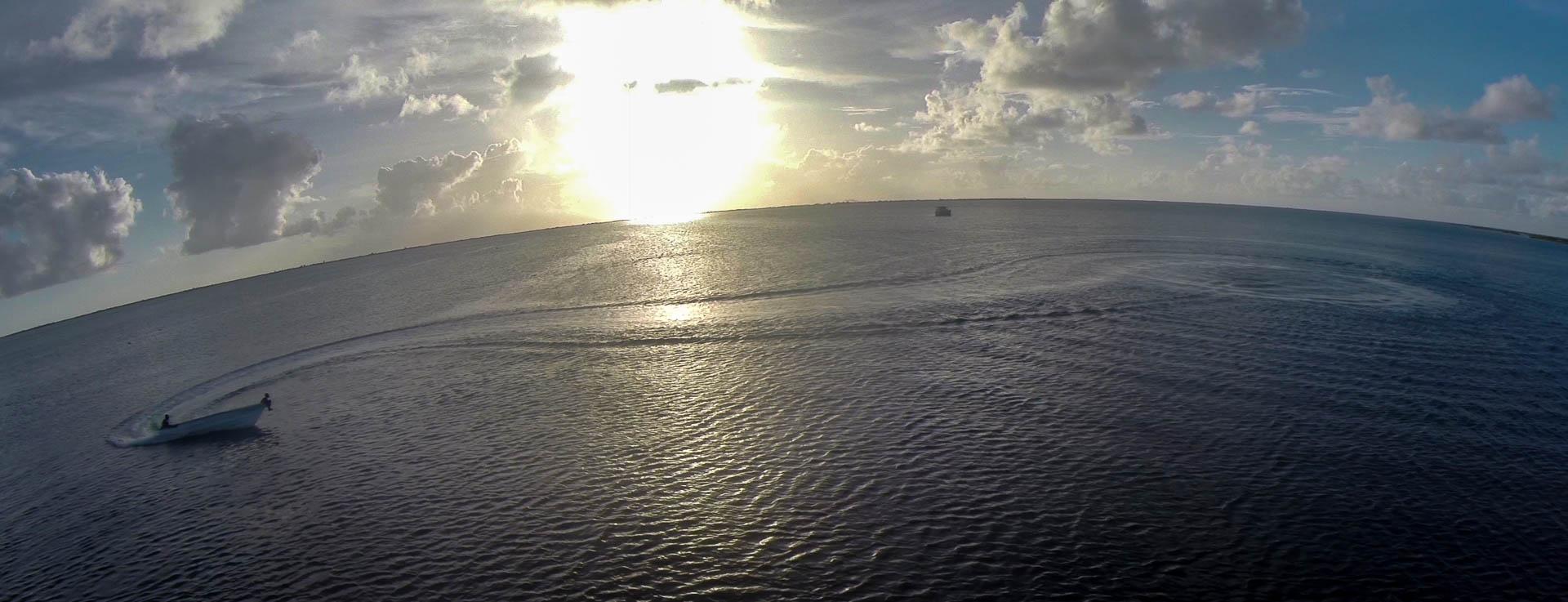 Kids doing donuts in Codrington Lagoon, Barbuda Island - video still, Tom Miller