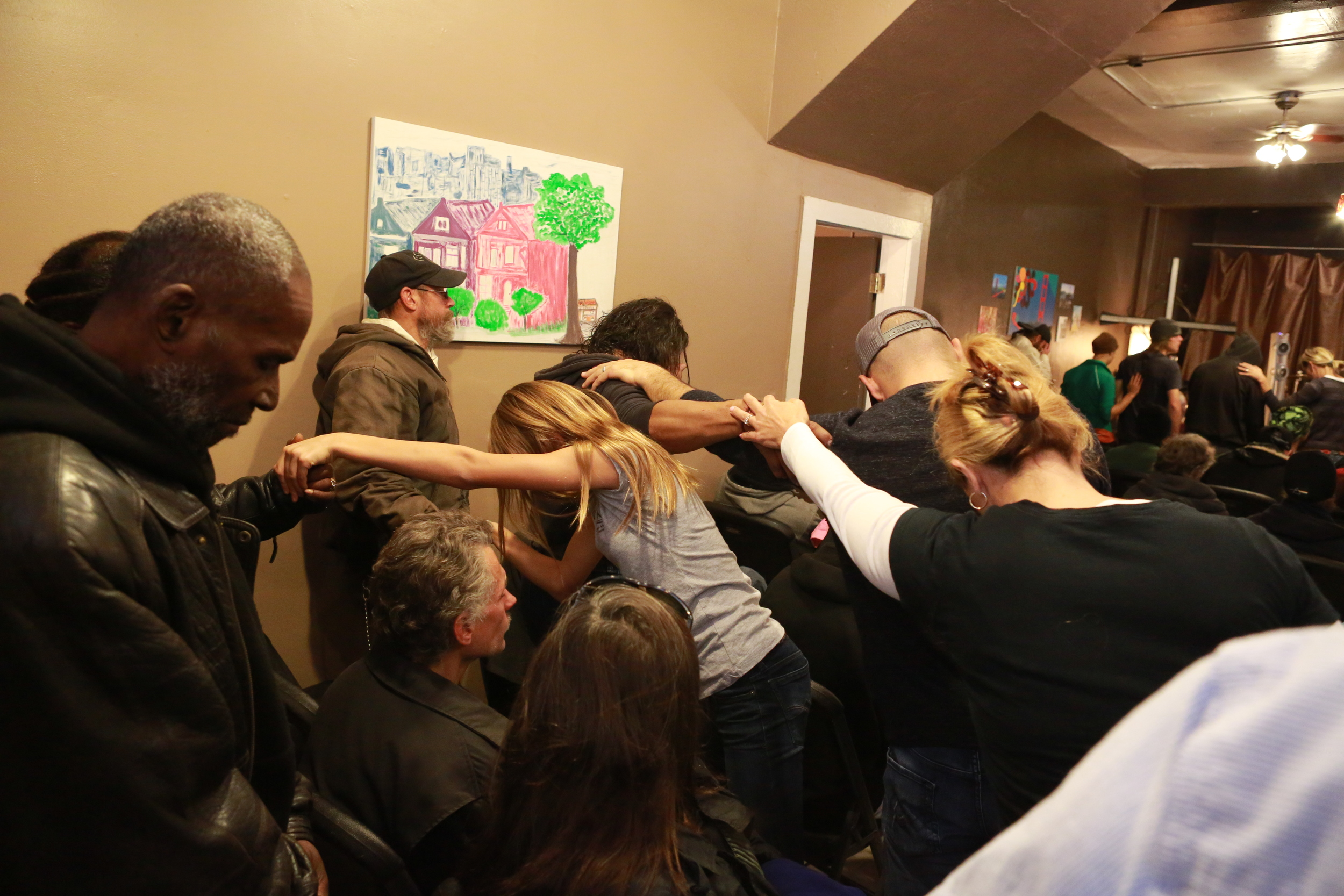 300 guests attended the sit-down Thanksgiving Meal. Here, they are praying for each other