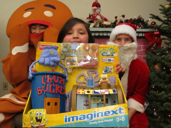 Sochie withher prize she won at the SF City Impact 2014 Kids Christmas Party.