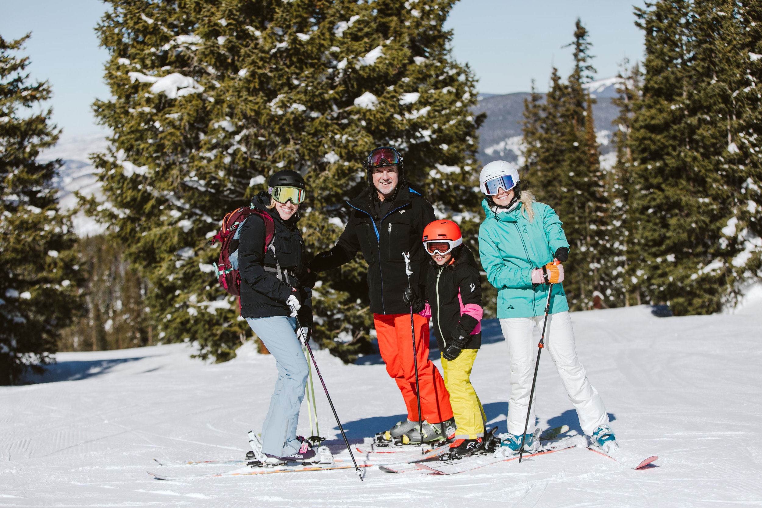 Krista (Cali's mom), Cali, my dad (because after all… he's the one who taught me to ski) and me on the top of Sourdough, Vail!