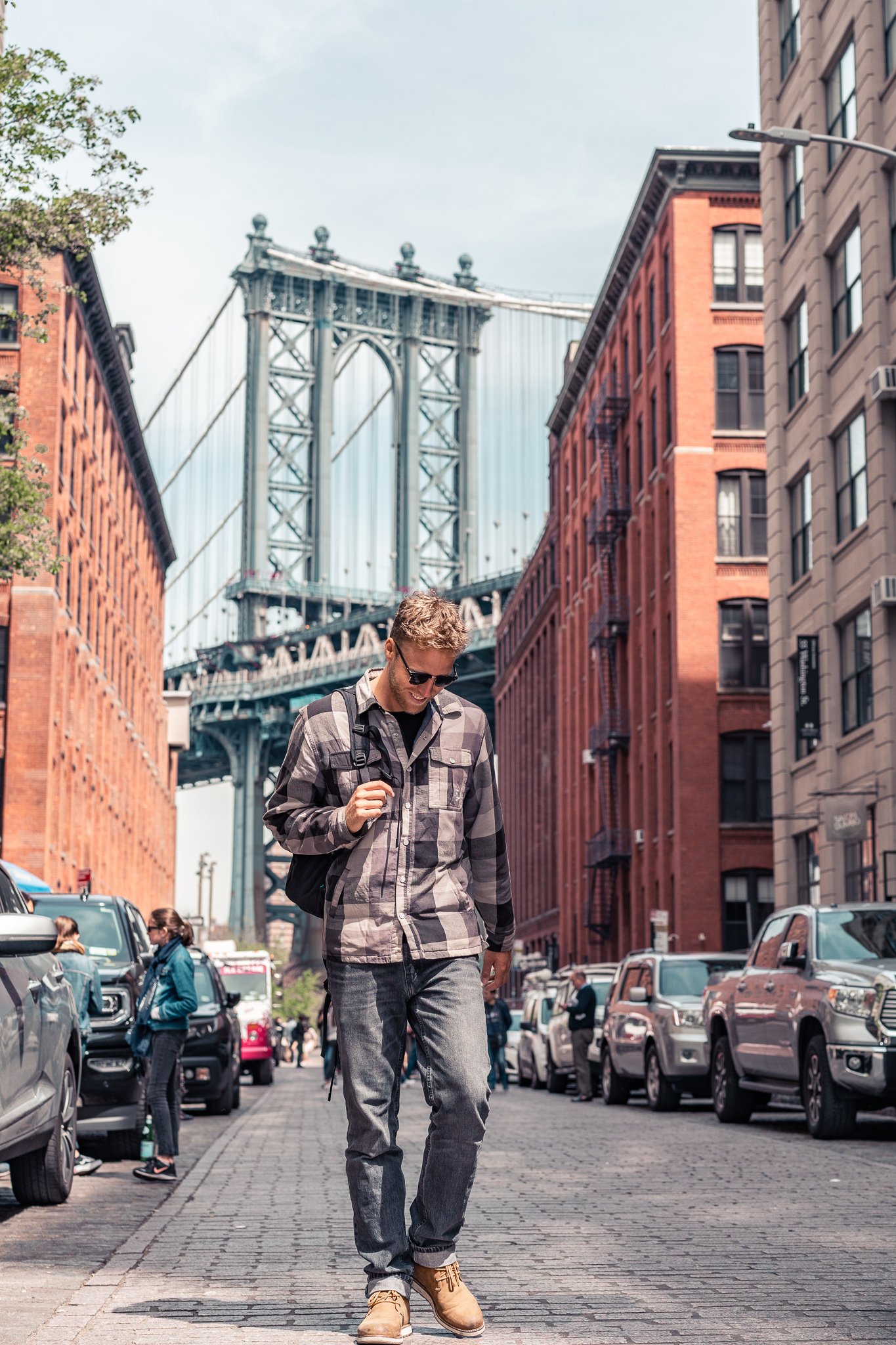 Dylan striking a pose in front of the iconic view of the Manhattan Bridge in Dumbo.