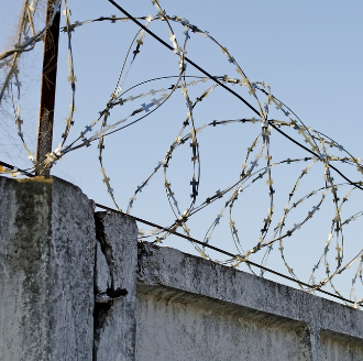 Barbed wire fence shutterstock_115918771.jpg.png