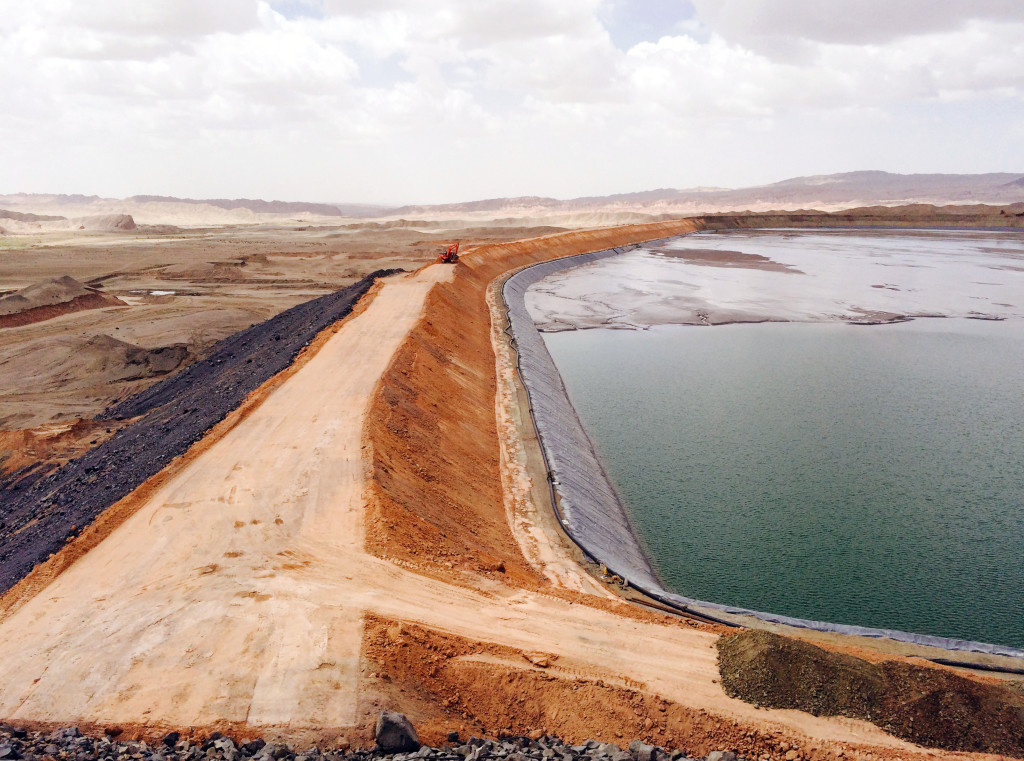 The tailings dam currently in use at Tanjianshan mine in China, filled with toxic chemicals. Dams like these leak, into the local water supply and contaminate the soil with mercury and cyanide