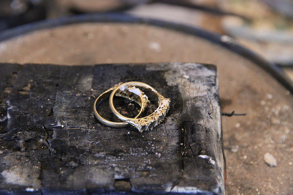 Rings prepped for melting on a block of Charcoal