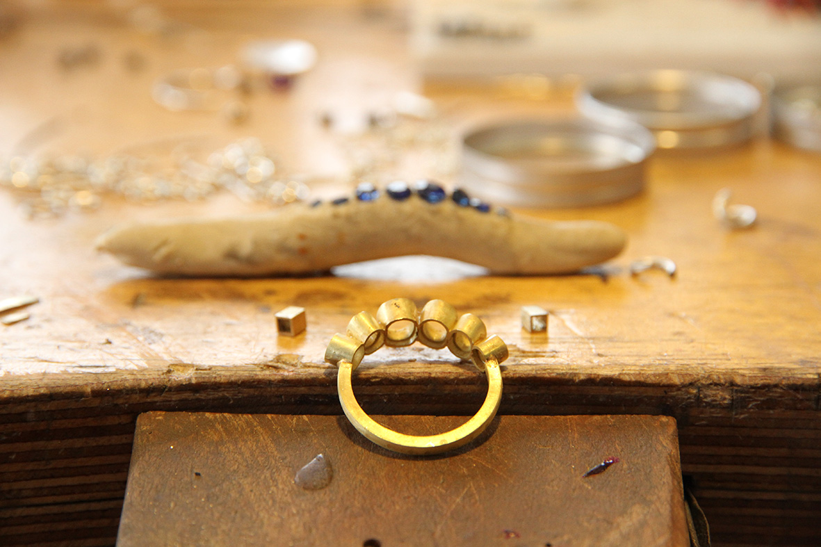 Sapphire ring being assembled