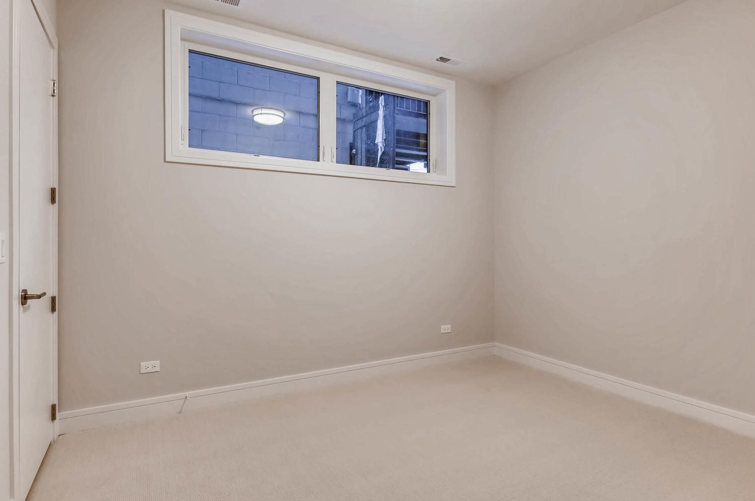 Guest bedroom at 877 N Marshfield Ave Unit 1, Chicago, IL