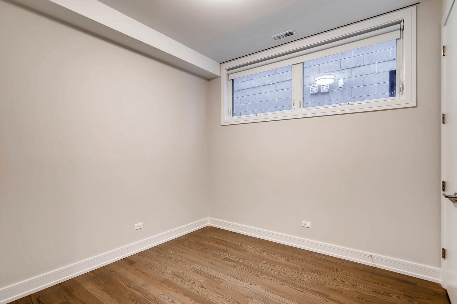 Guest bedroom at 877 N Marshfield Ave Unit 2, Chicago, IL