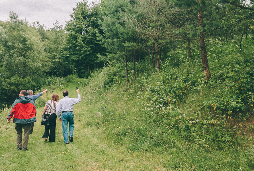 From left, cousin Volodya, the village Mayor, cousin Ewa, and Dad, pointing out the boundaries of the overgrown Gburyk land.