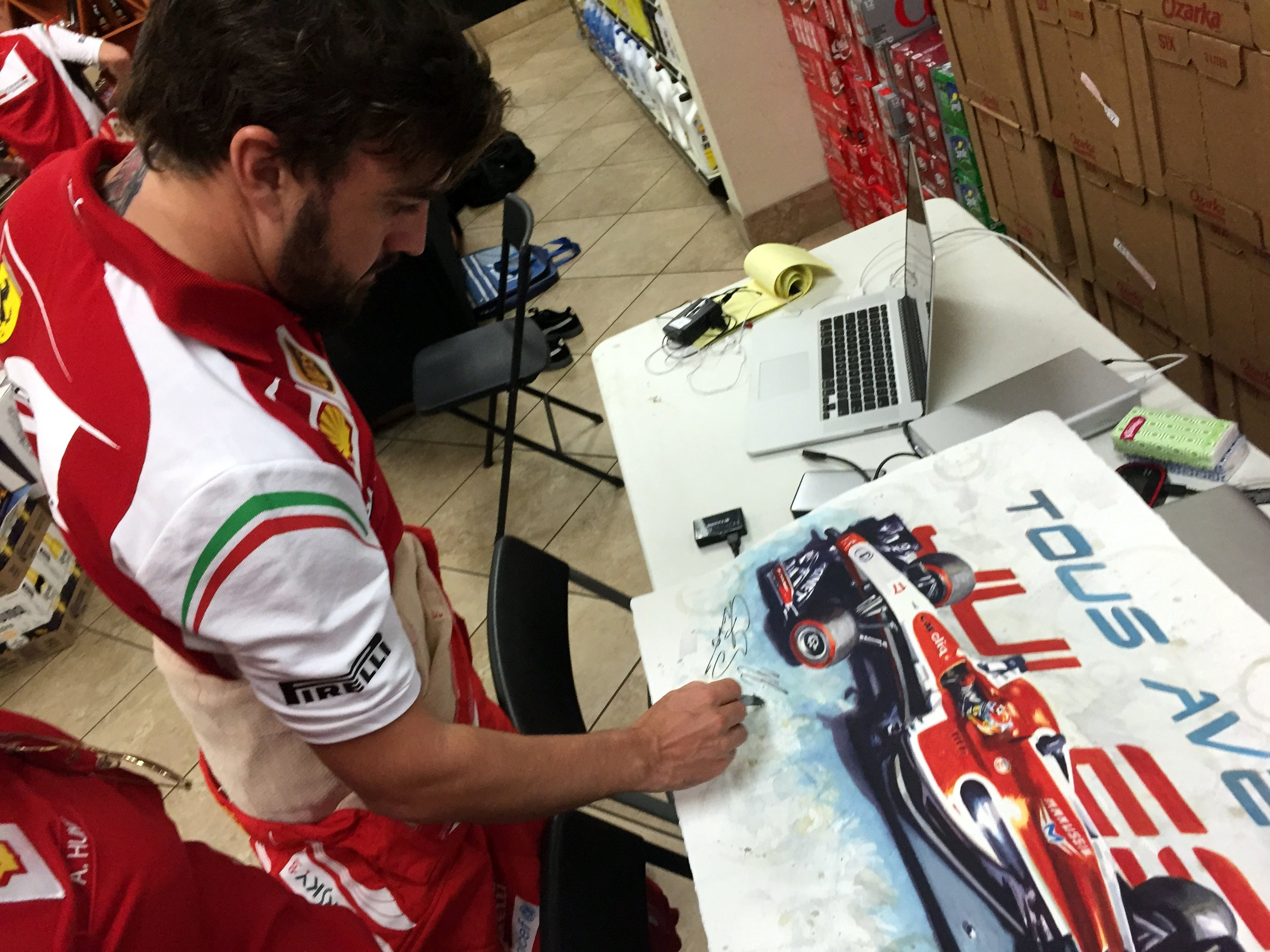 Fernando Alonso signing a tribute painting 'With You' of Jules Bianchi at the USGP