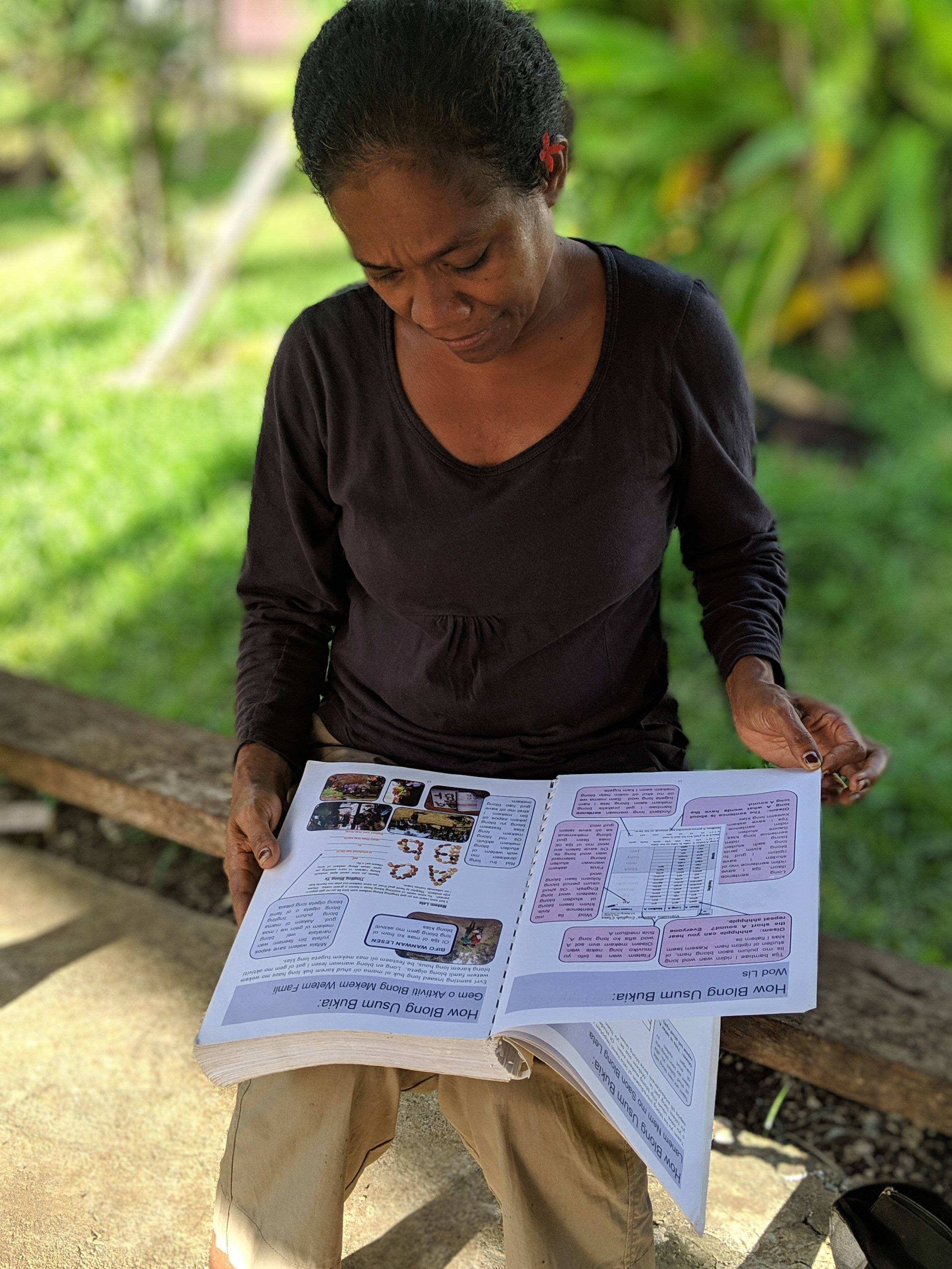 Vanuatu Board Member reviewing literacy curriculum.