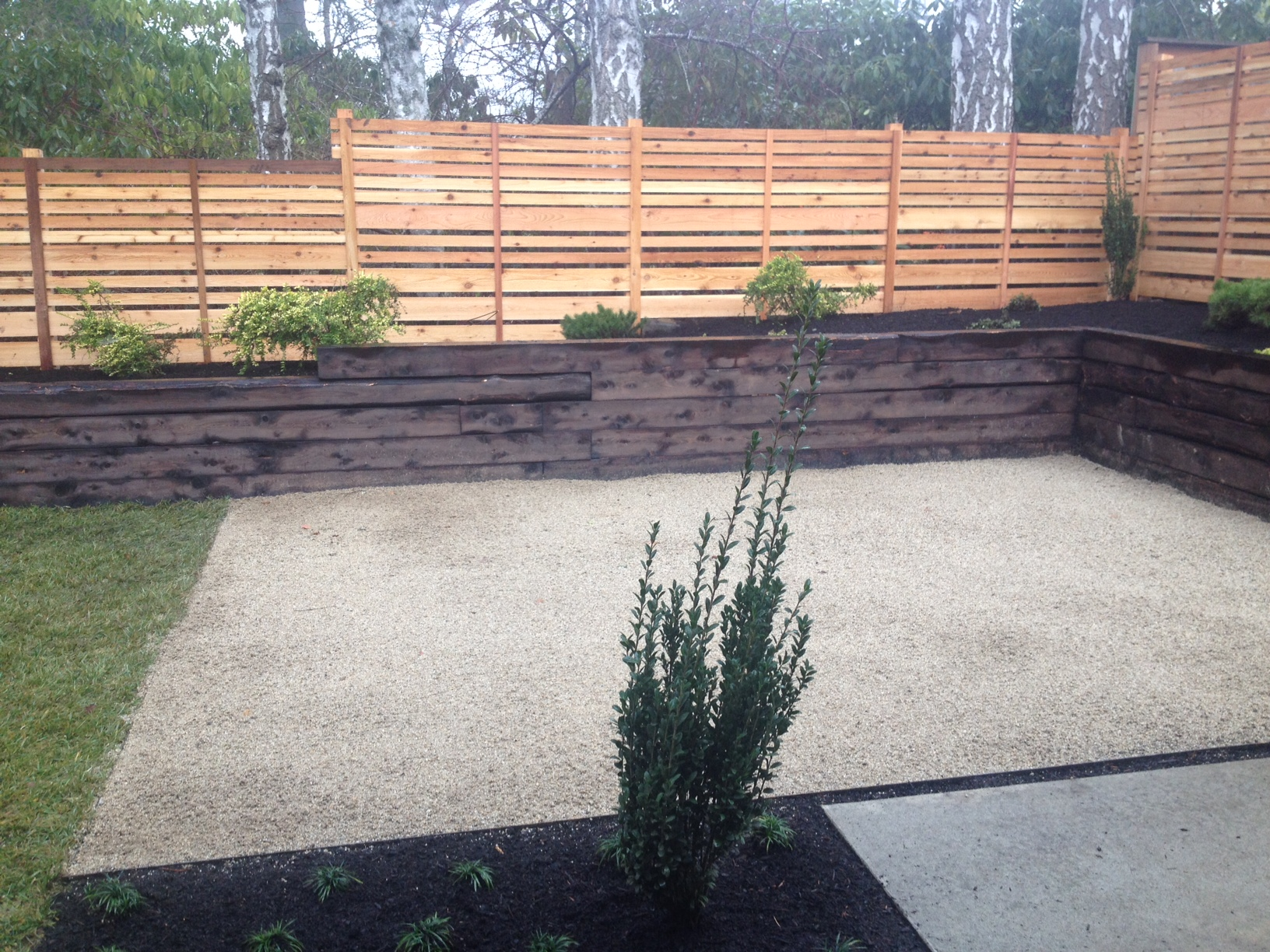 Shou-sugi-ban finish on a juniper retaining wall.