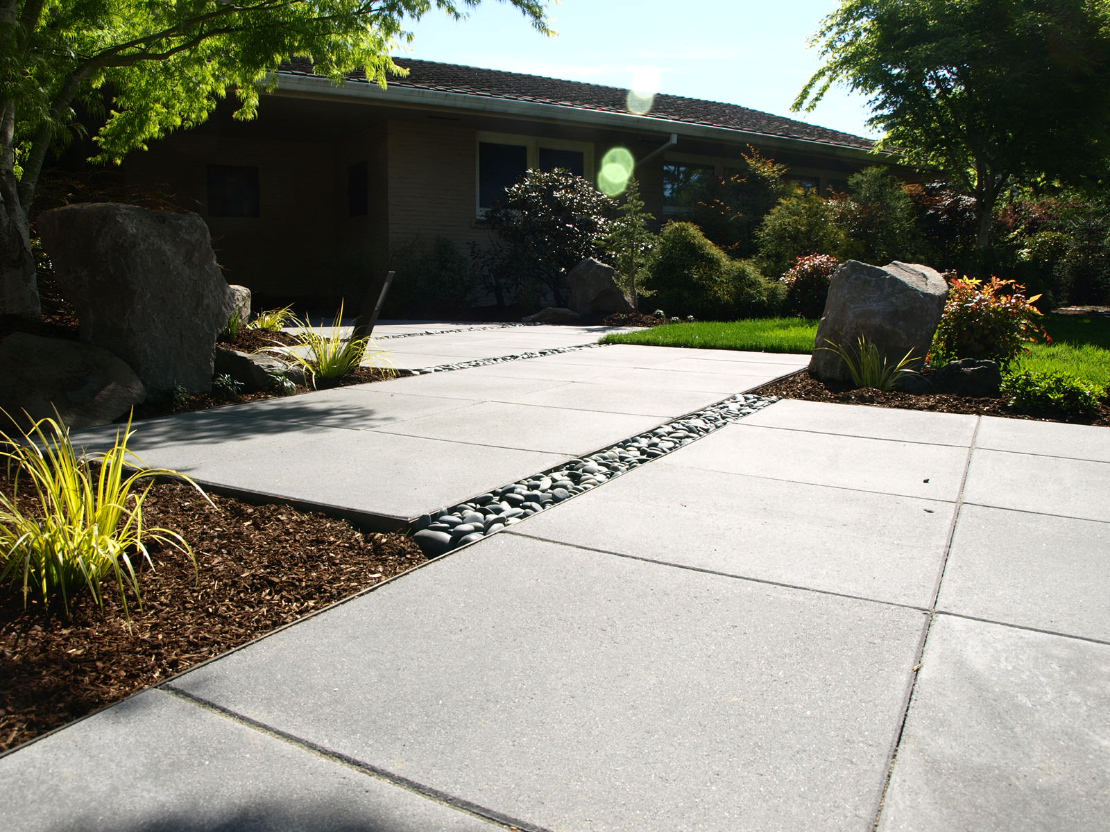 This  modern landscape design , in SW Portland, only involved the front entry path and garden. The limited scope meant it only took a few weeks to get the design completed.