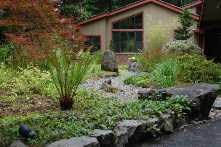 his  Lake Oswego garden  has contributions from at least three landscape designers and the homeowner!