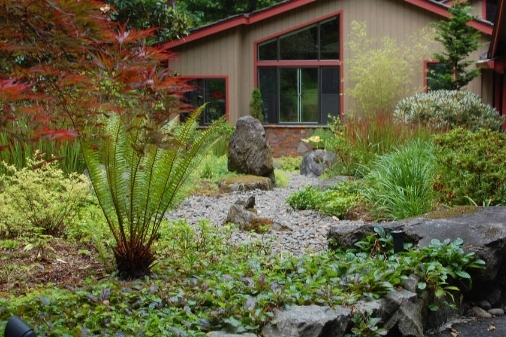 Dry creek and plantings replaced a moss filled lawn in this Lake Oswego landscape.