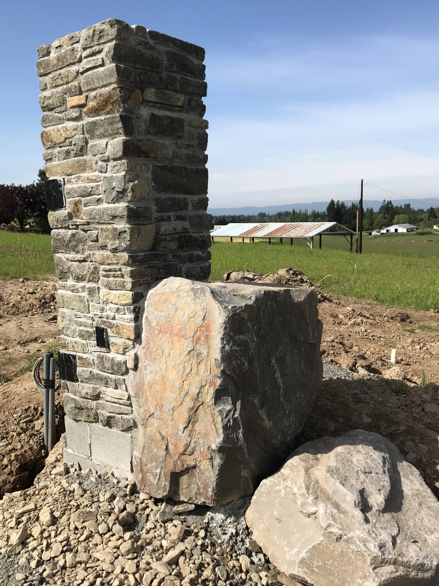 Stone masonry pillar for future gate.