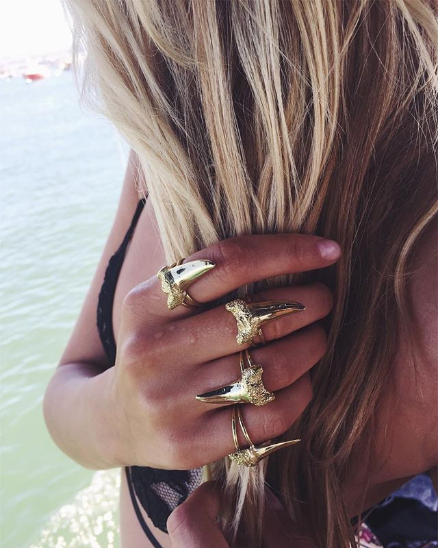 Its Duffy Boat weather! ☀️ Follow @naylnunez to see how she rocks her Brass SHARKY rang #sharkattack #risingbluejewelry