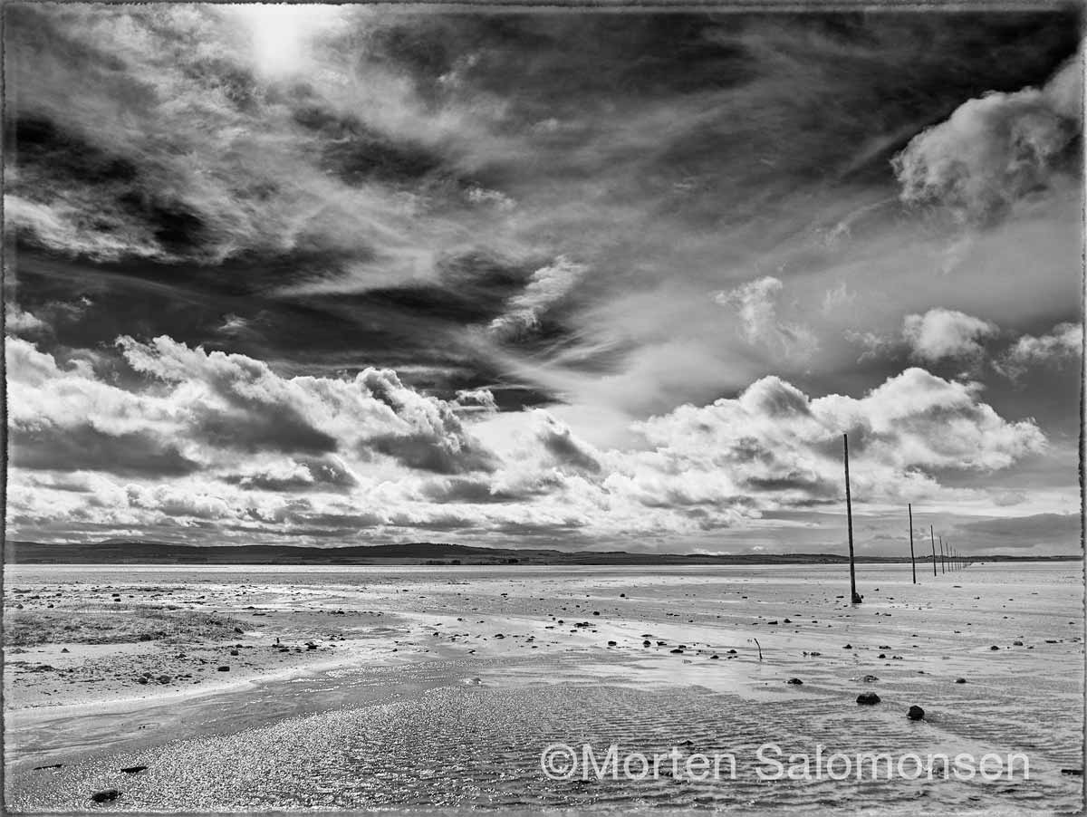 Northumberland, Lindisfarne island looking towards the mainland with the Pilgrim's Way to the right