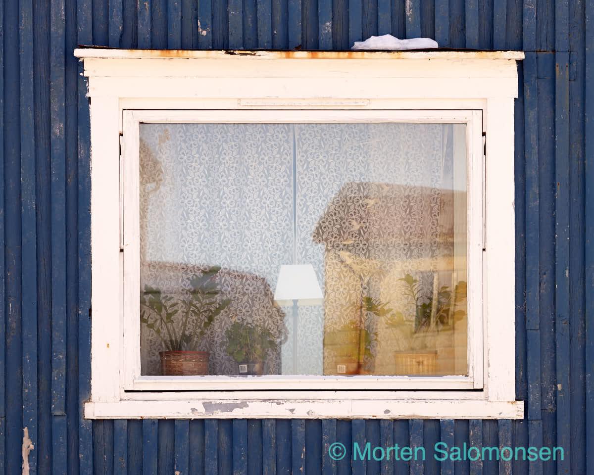 Window, blue wall